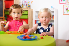 stock-photo-17039283-toddlers-having-healthy-snacks-in-a-nursery